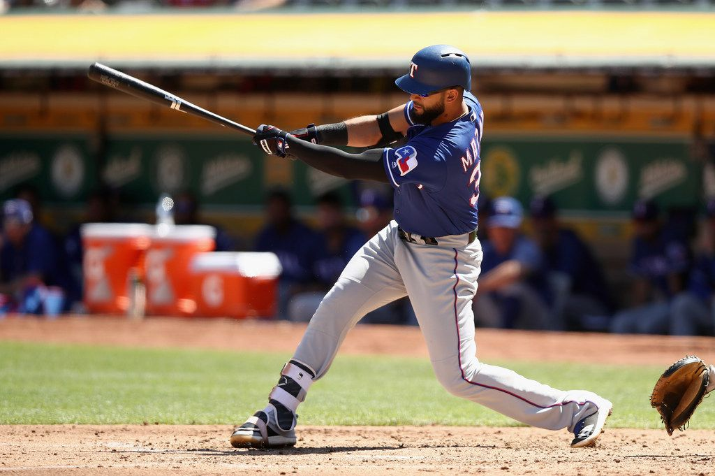 OAKLAND, CA - SEPTEMBER 08:  Nomar Mazara #30 of the Texas Rangers hits a double that scored two runs in the third inning against the Oakland Athletics at Oakland Alameda Coliseum on September 8, 2018 in Oakland, California.  (Photo by Ezra Shaw/Getty Images)