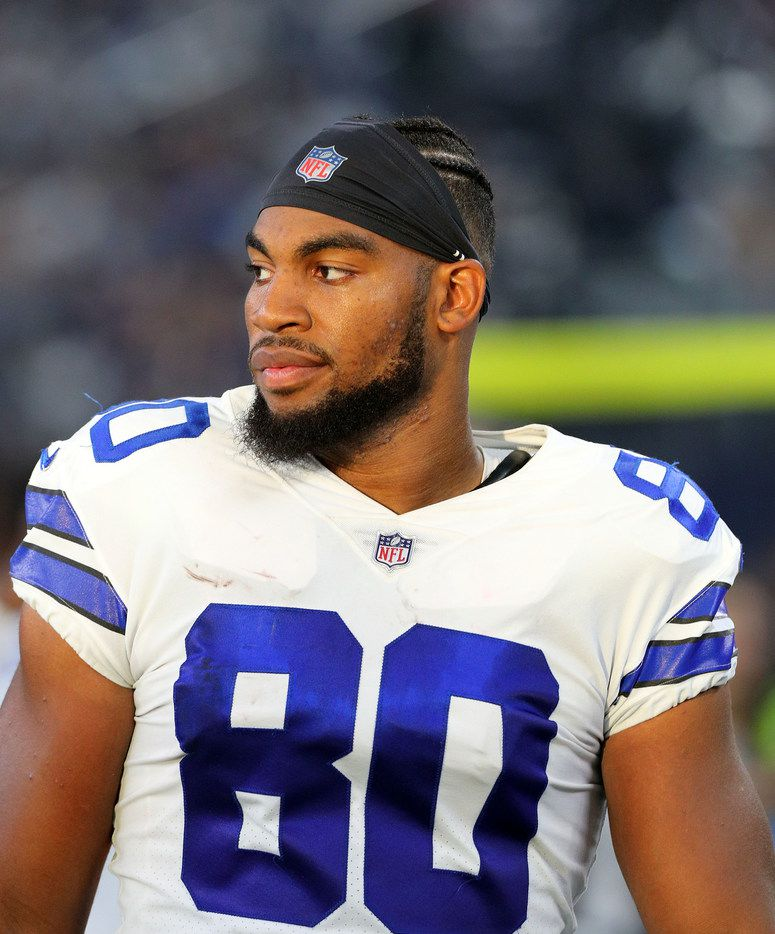 ARLINGTON, TX - AUGUST 26:  Rico Gathers #80 of the Dallas Cowboys stands on the sidelines in the first quarter of a preseason football game against the Arizona Cardinals at AT&T Stadium on August 26, 2018 in Arlington, Texas.  (Photo by Richard Rodriguez/Getty Images)