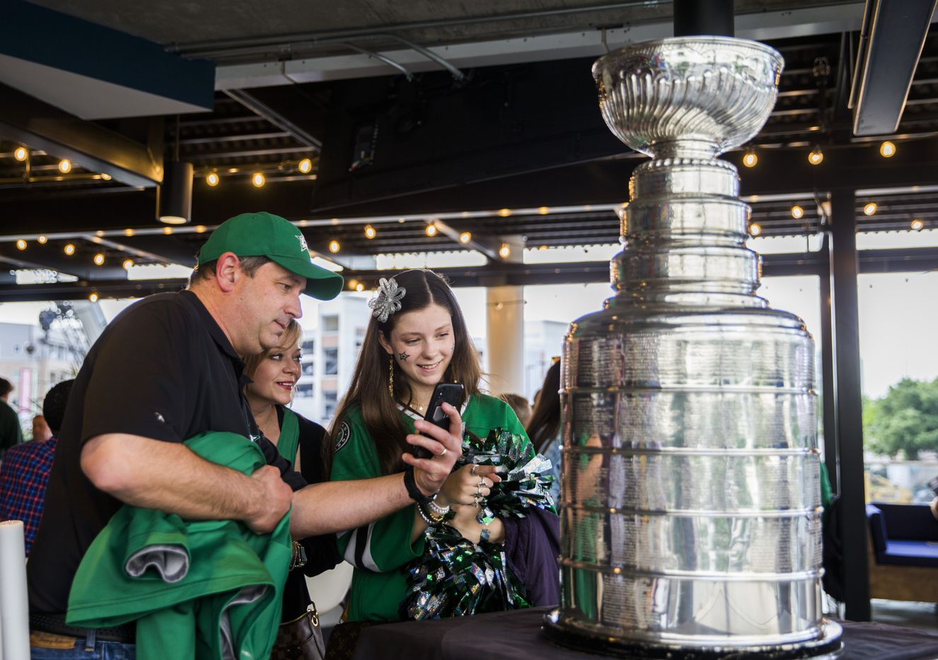 Fans take photos with the Stanley Cup at DIBS on VICTORY before Game 6 of the Stars-Predators series at American Airlines Center.
