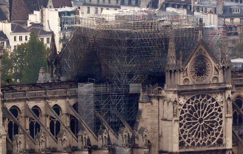 Notre Dame cathedral is pictured from the top of the Montparnasse tower on Tuesday, April 16, 2019 in Paris. Firefighters declared success in an over 12-hour battle to extinguish an inferno engulfing Paris' iconic Notre Dame cathedral.