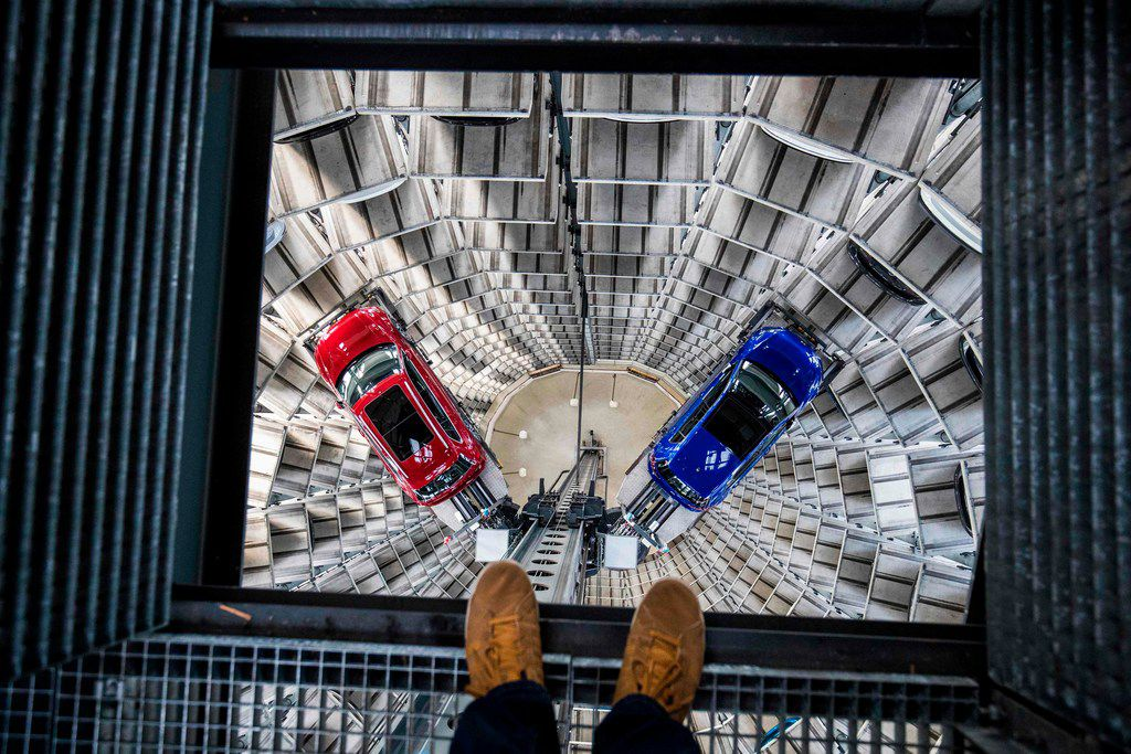 In this file photo taken on March 14, 2017, German carmaker Volkswagen's cars are seen at the storage facility auto tower at the company headquarters in Wolfsburg, northern Germany.  Germany's years-long run of steady growth came to a screeching halt in the third quarter, official data showed on November 14, 2018, with an expected bottleneck in the vital car industry matched by broader structural concerns.