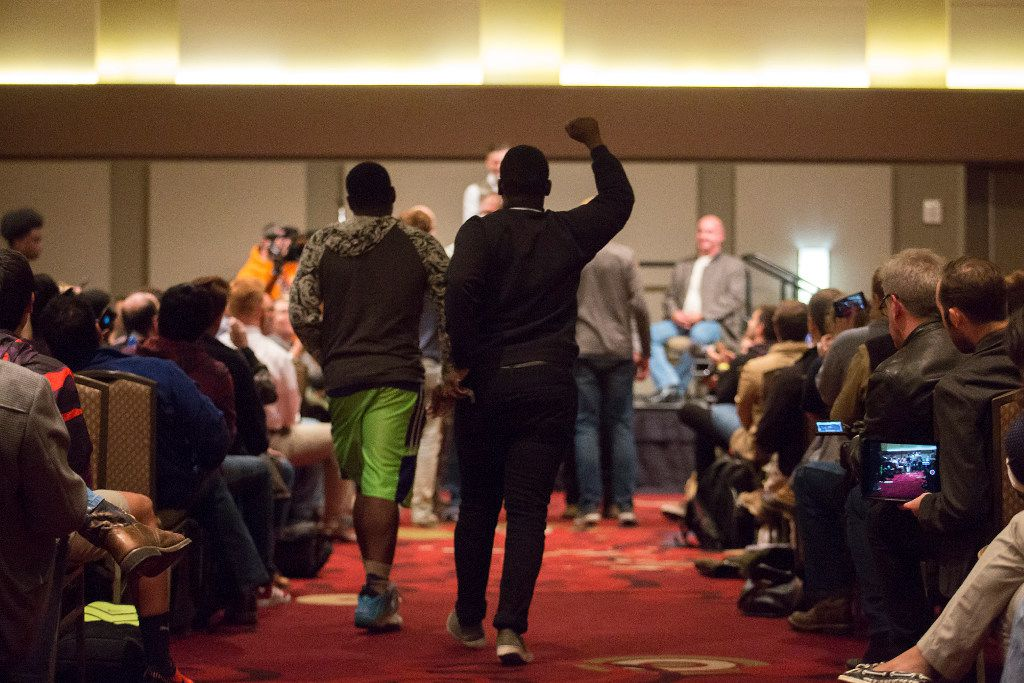 """Protestors approach the stage before a minor scuffle broke out as Richard Spencer speaks at the Memorial Student Center at Texas A&M University on Tuesday, Dec. 6, 2016, in College Station, Texas. Spencer, a Dallas native and a self-professed founder of the """"alt right"""" movement, will speak at the campus at the invitation of a white nationalist and former student.  The university hosted the Aggies United event at Kyle Field, the university's football stadium, to overlap with Spencer's speech. (Smiley N. Pool/The Dallas Morning News)"""