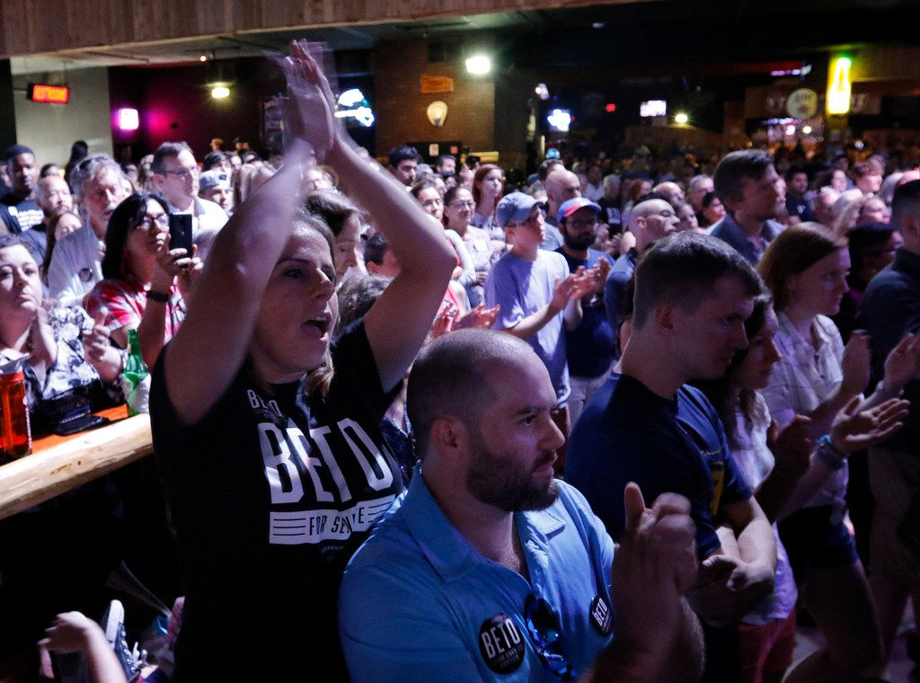 Gaby Diaz, a 10th-grade teacher, left, and Brandon Wooley, center, a Navy veteran, clap as Beto O'Rourke talks to voters during a rally at the Houston Stampede Event Center in Houston Texas, on Saturday, September 8, 2018. Ted Cruz campaigned in Humble, Texas, Texas on Saturday, while Beto O'Rourke campaigned a few miles away in Houston, Texas.