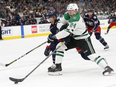 Dallas Stars' Roope Hintz, right, of Finland, tries to shoot as Columbus Blue Jackets' Riley Nash defends during the first period of an NHL hockey game Wednesday, Oct. 16, 2019, in Columbus, Ohio.