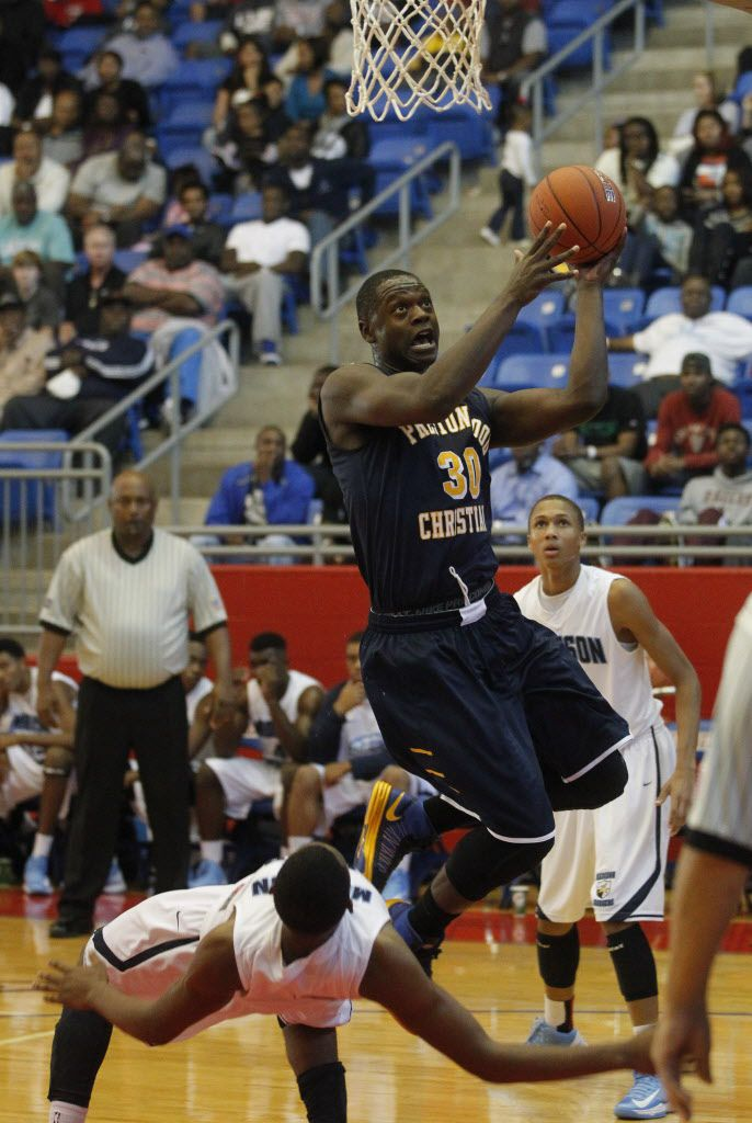 Prestonwood's Julius Randle (30) draws a foul from Madison Prep Academy's Darell Martin (22)  during the Thanksgiving Hoopfest  at Sandra Meadows Arena in Duncanville on November 23, 2012.  (Michael Ainsworth/The Dallas Morning News) 02172013xSPORTS