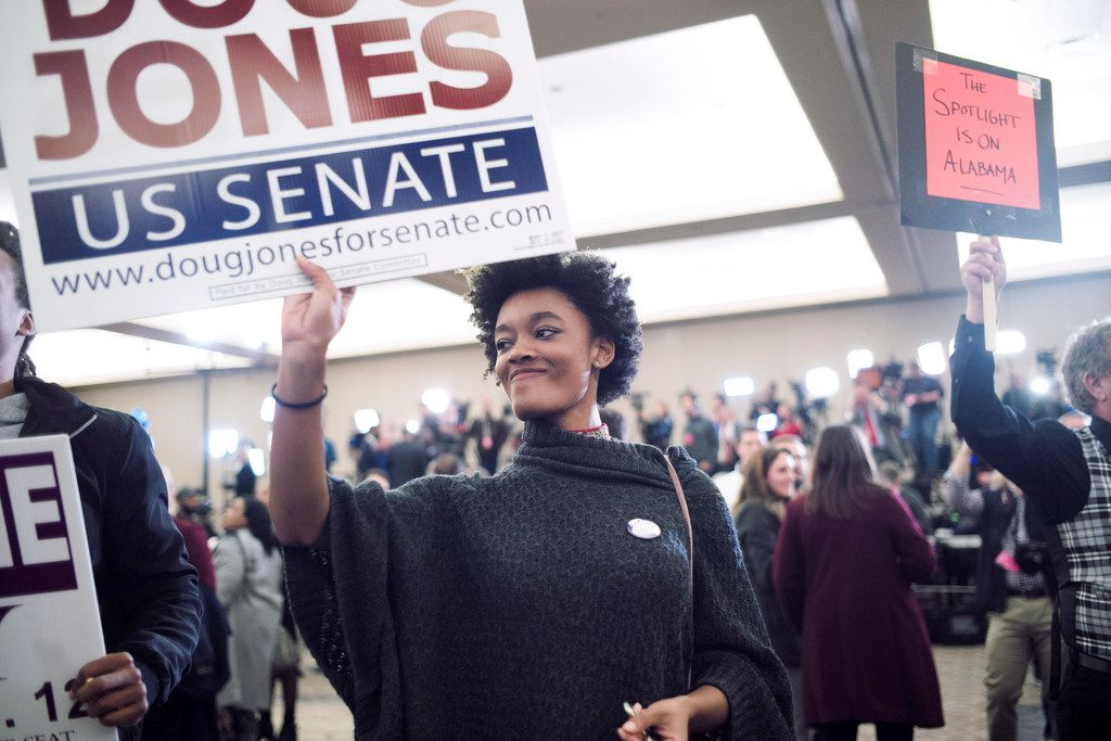 Supporters of Democrat Doug Jones watched election results in the Senate race come in last week at the Sheraton Hotel in Birmingham, Ala. Some Democrats say one lesson from Jones' victory is that the party benefits when it puts more resources into reaching blacks and other minorities.