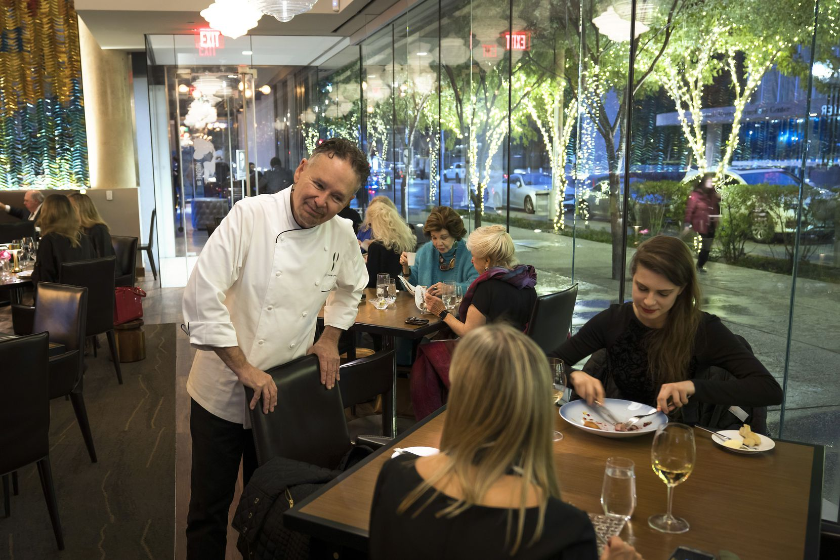 Stephan Pyles visits with diners at Flora Street Cafe in October.