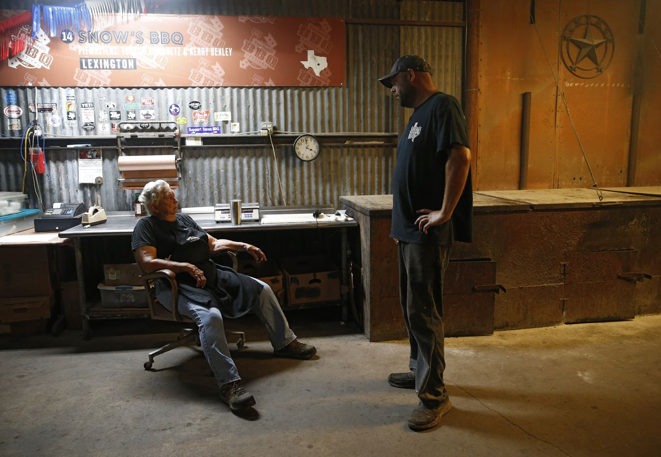 Tootsie Tomanetz and Clay Cowgill talk in between tending to the meat cooking in the early morning hours on Aug. 11.