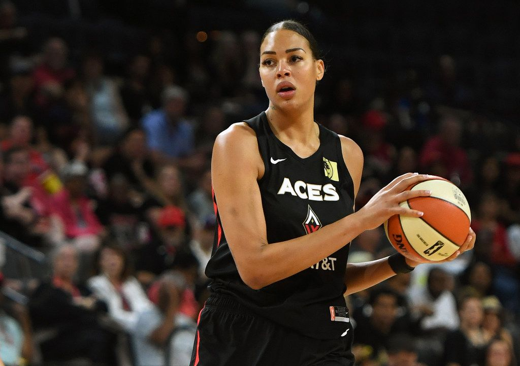 LAS VEGAS, NEVADA - JUNE 02:  Liz Cambage #8 of the Las Vegas Aces looks to pass against the Connecticut Sun during their game at the Mandalay Bay Events Center on June 2, 2019 in Las Vegas, Nevada. The Sun defeated the Aces 80-74. NOTE TO USER: User expressly acknowledges and agrees that, by downloading and or using this photograph, User is consenting to the terms and conditions of the Getty Images License Agreement.  (Photo by Ethan Miller/Getty Images )