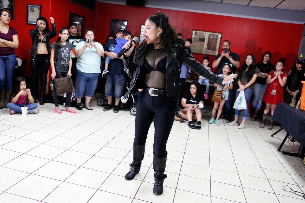Cynthia Camero, 28, of Grand Prairie, performs during a talent contest at #214Selena: A Tribute to Selena at Country Burger restaurant in Dallas, Saturday, March 25, 2017.