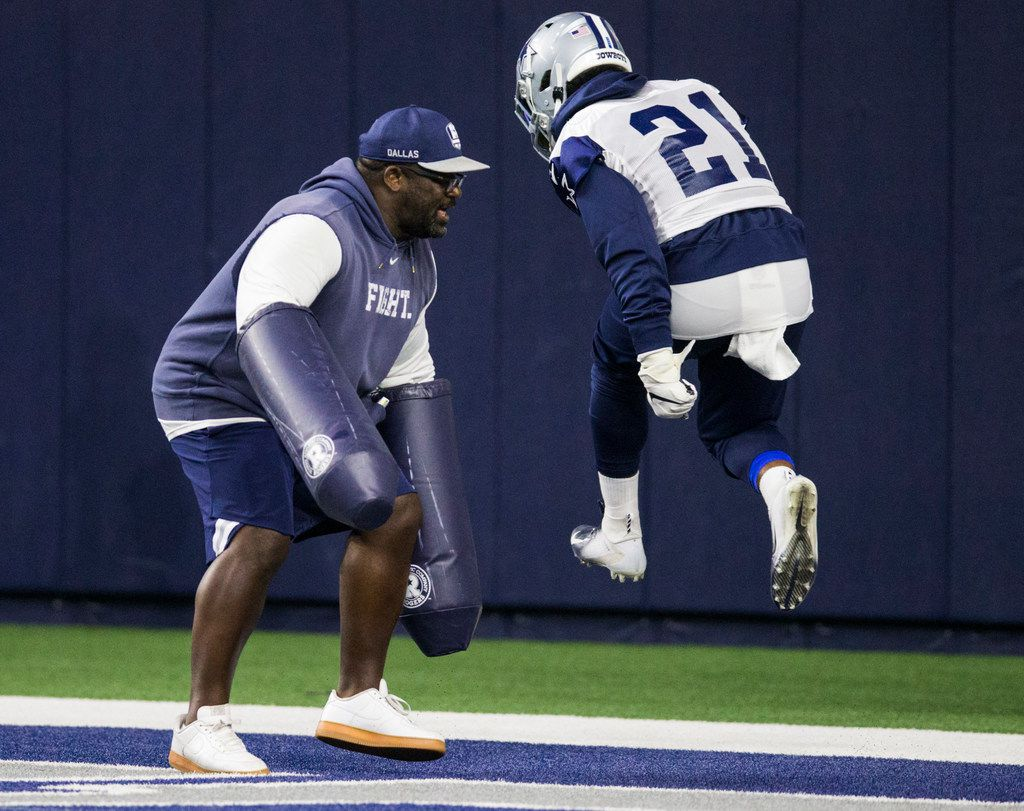 Dallas Cowboys running back Ezekiel Elliott (21) runs a drill with running backs coach Gary Brown during a Dallas Cowboys OTA practice on Wednesday, May 29, 2019 at The Star in Frisco. (Ashley Landis/The Dallas Morning News)