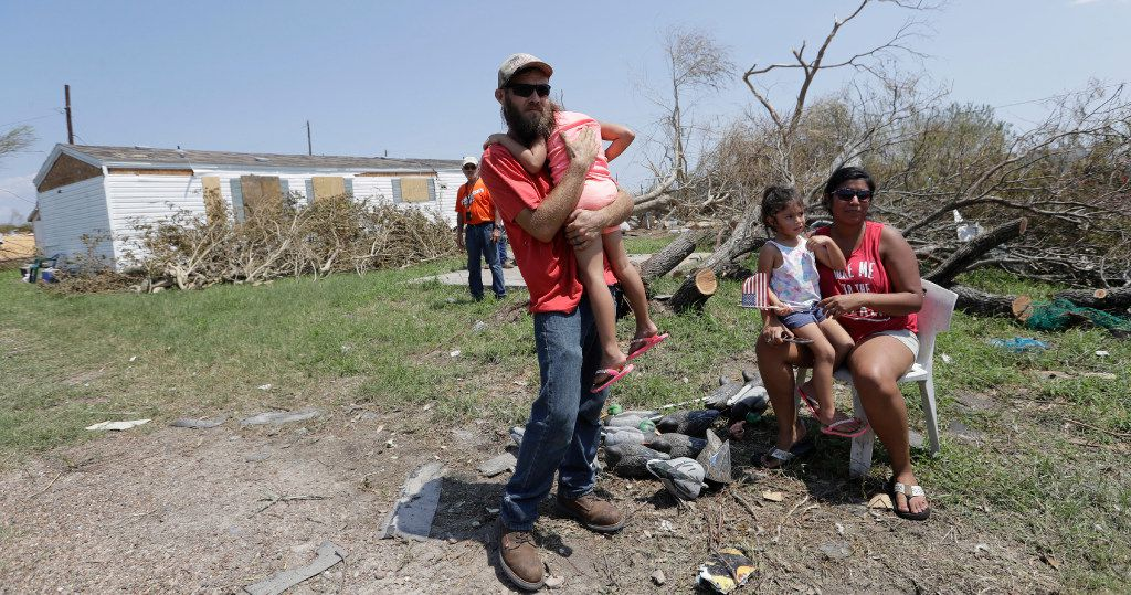Louis Naro waits with his family for a visit from Vice President Mike Pence, Thursday, Aug. 31, 2017, in Rockport, Texas, an area that received heavy damage from Hurricane Harvey. (AP Photo/Eric Gay)