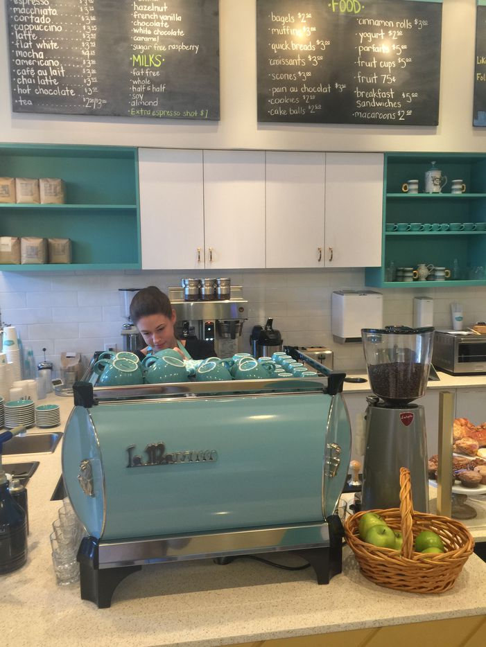 The blue La Marzocco machine sits forefront as a reminder that coffee is the center of the shop.
