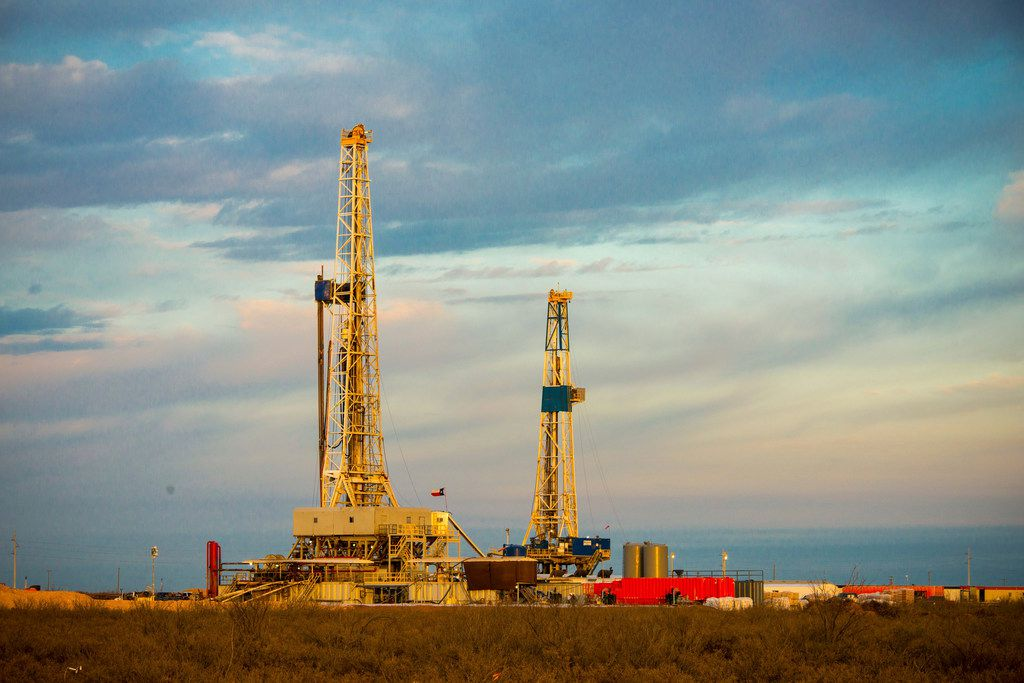 A photo provided by Exxon Mobil shows drilling rigs that are part of the company's operations in the Permian Basin.
