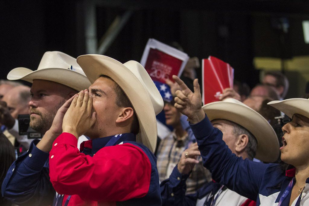 """Texas delegates chant """"Roll Call Vote"""" on the floor of the Republican National Convention on Monday, July 18, 2016, in Cleveland. An effort by anti-Trump delegates to force a roll-call vote on convention rules failed during the opening session of the convention.  (Smiley N. Pool/The Dallas Morning News)"""