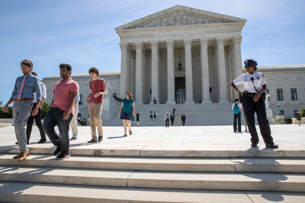 Visitors depart the Supreme Court early Monday, June 25, 2018. The justices are expected to hand down decisions this week as the court's term comes to a close. (AP Photo/J. Scott Applewhite)