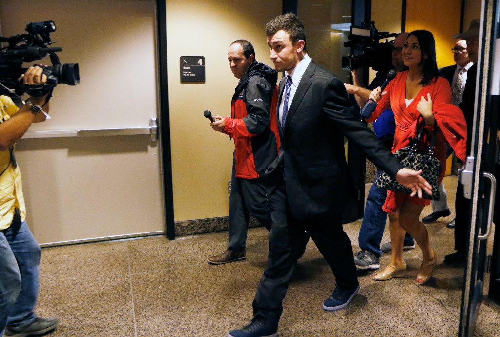 Johnny Manziel left the Frank Crowley Courts Building on Thursday, after prosecutors said in court that they have reached a tentative deal with his defense team to dismiss a misdemeanor assault charge against him. (David Woo/Staff Photographer)