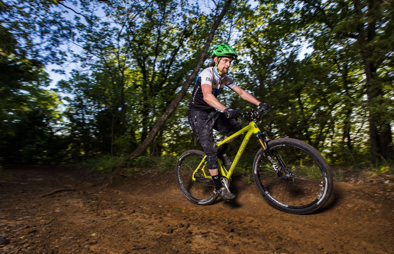 Barry Bishop rides his mountain bike on the North Shore Trail near Lake Grapevine.