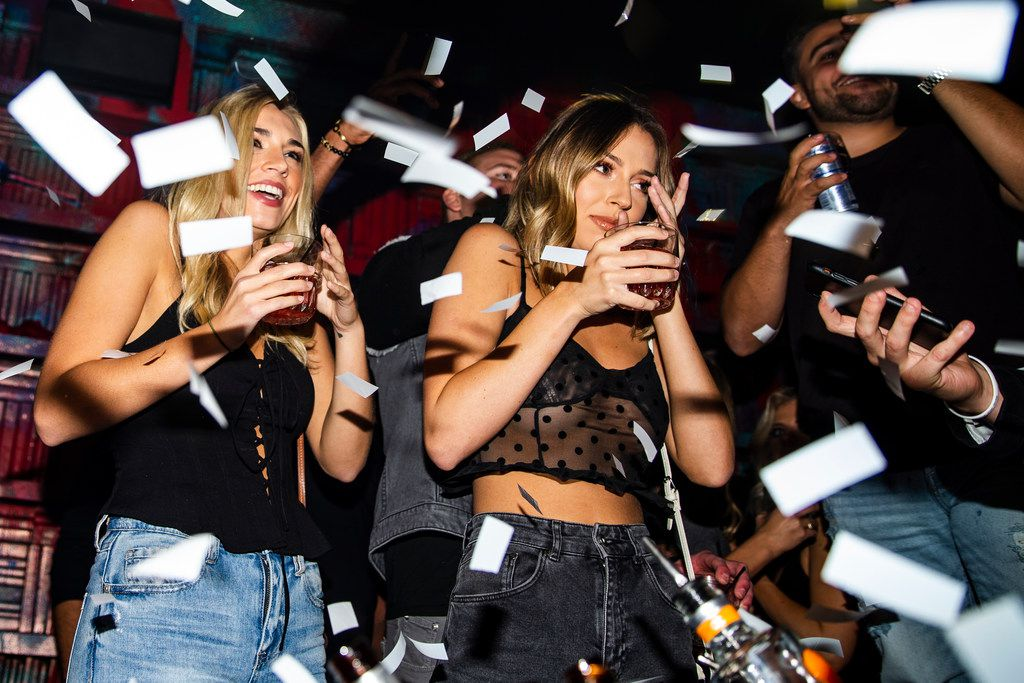 Landyn Dees , left, and Jessica Moreal react after a hostesses popped confetti at One Sette in Dallas on Friday, October 12, 2018. (Shaban Athuman/The Dallas Morning News)