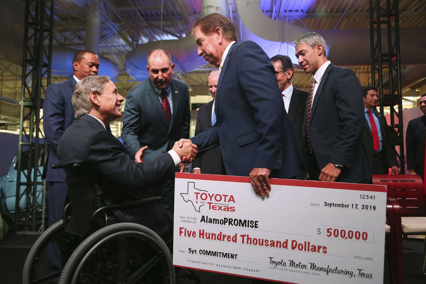 Alamo Colleges District Board of Directors Vice-President Joe Alderete, Jr. shakes hands with Texas Gov. Greg Abbott after an event announcing a $391 million expansion at the San Antonio Toyota plant, Tuesday, Sept. 17, 2019. The district's AlamoPROMISE program will received a $500,000 commitment from Toyota.