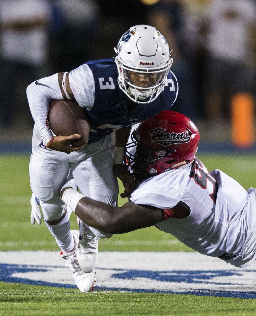 Allen quarterback Raylen Sharpe (3) is tackled by Cedar Hill defensive tackle Leon Young (99) during the second quarter of a high school football game between Allen and Cedar Hill on Friday, August 30, 2019 at Eagle Stadium in Allen. (Ashley Landis/The Dallas Morning News)