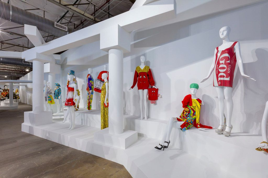 """Product packaging is a theme in some of the fashions on display at Jeremy Scott, Installation View of """"VIVA AVANT GARDE: A Jeremy Scott Retrospective"""" at Dallas Contemporary"""