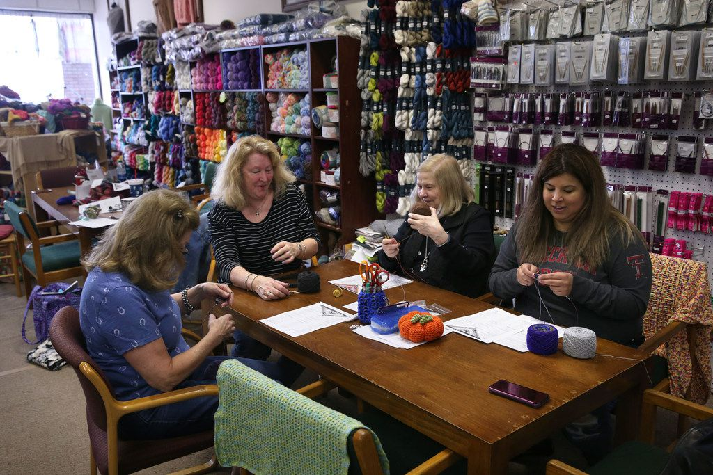 From left, Lee DeVine of Plano, Yarn and Stitches owner Hope Logan, Barbara Thomas and Alysha Henry talk about how relaxing knitting can be while they make butterfly shawls during a workshop at the knitting store.