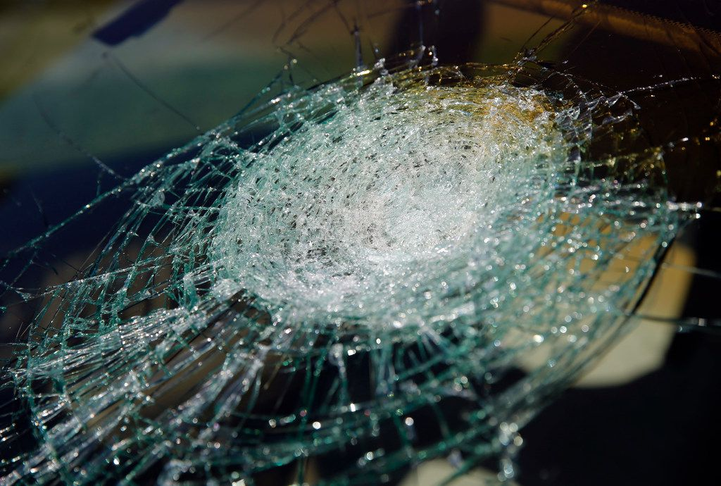 Hail damage left a giant spiderweb crack on the windshield of a car in Coppell on Wednesday.