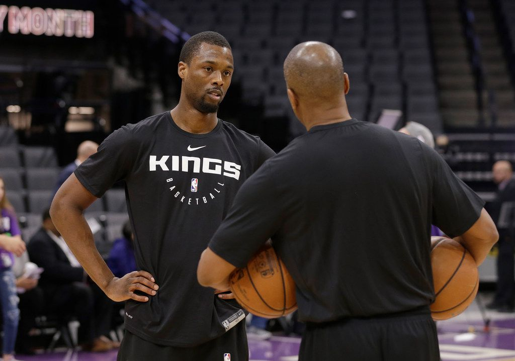 Newly acquired Sacramento Kings forward Harrison Barnes left, talks with Kings assistant coach Elston Turner before the Kings' NBA basketball game against the Miami Heat on Friday, Feb. 8, 2019, in Sacramento, Calif. Barnes was traded Wednesday from the Dallas Mavericks in exchange for forwards Zach Randolph and Justin Jackson. (AP Photo/Rich Pedroncelli)