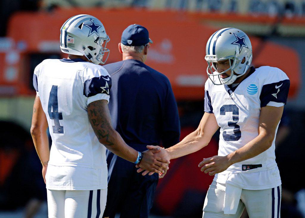 Dallas Cowboys quarterback Dak Prescott (4) high-fives quarterback Mark Sanchez during practicing Wednesday, October 12, 2016 at The Star in Frisco, Texas. (G.J. McCarthy/The Dallas Morning News)