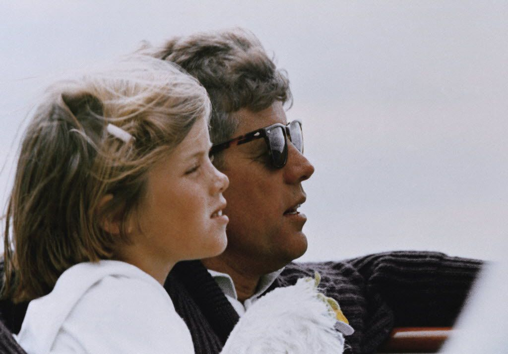 In this 1962 file photo, President John F. Kennedy and his daughter, Caroline, sail off Hyannis Port, Mass.