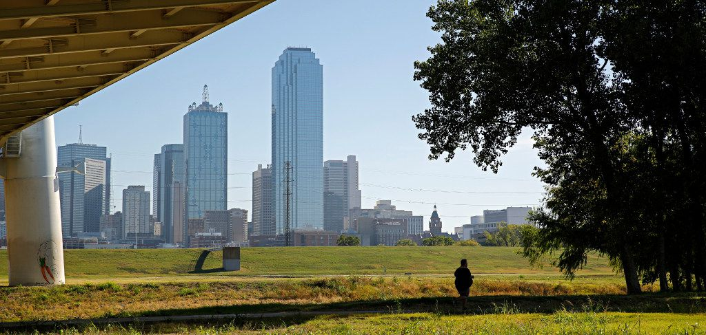 A jogger runs along a trail along the Trinity River near downtown Dallas Monday, October 31, 2016. Mayor Mike Rawlings announced Monday the donation of $50 million to help fund a park in the area. (G.J. McCarthy/The Dallas Morning News)