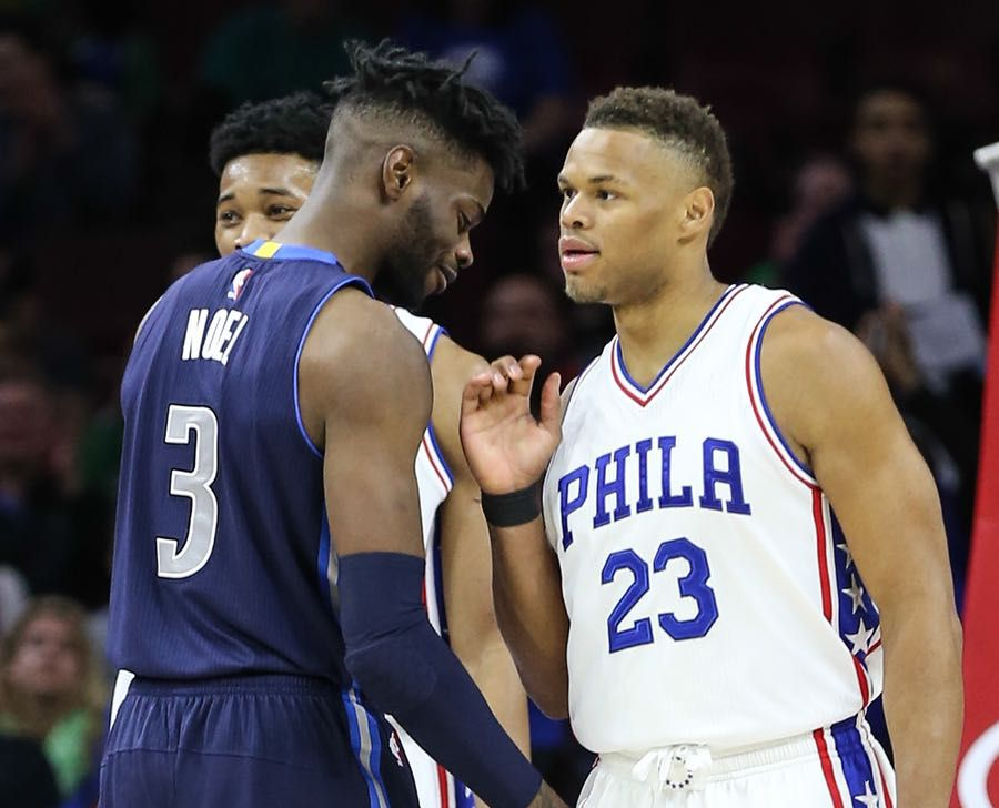 Philadelphia 76ers guard Justin Anderson (23) chats with Dallas Mavericks' Nerlens Noel (3) at the Wells Fargo Center on Friday, March, 17, 2017. (Steven M. Falk/Philadelphia Inquirer/TNS)