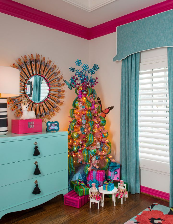 Designer Shay Geyer's daughter's room is decorated with a pink tree that has puppy ornaments and complements the room's butterfly theme.