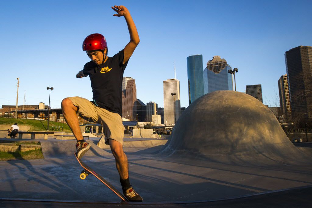 August Guerrero rides in the shadow of the downtown skyline at Lee and Joe Jamail Skatepark in Buffalo Bayou Park on Monday, Feb. 9, 2015, in Houston. (Smiley N. Pool/The Dallas Morning News)