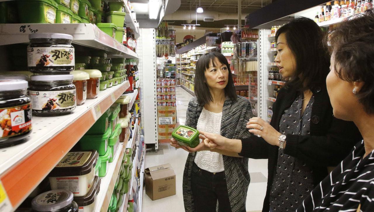 Cheryl Collett, Hyejon Ko-Suk and Lisa Shin shop at H Mart in Korean town in Carrollton.