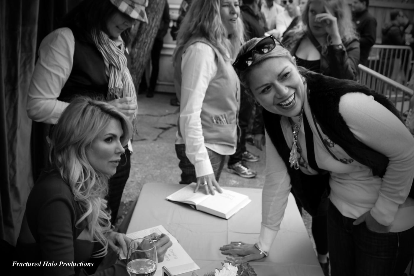 'Real Housewife' of Beverly Hills Brandi Glanville signs books for fans at the Grapevine Bar.