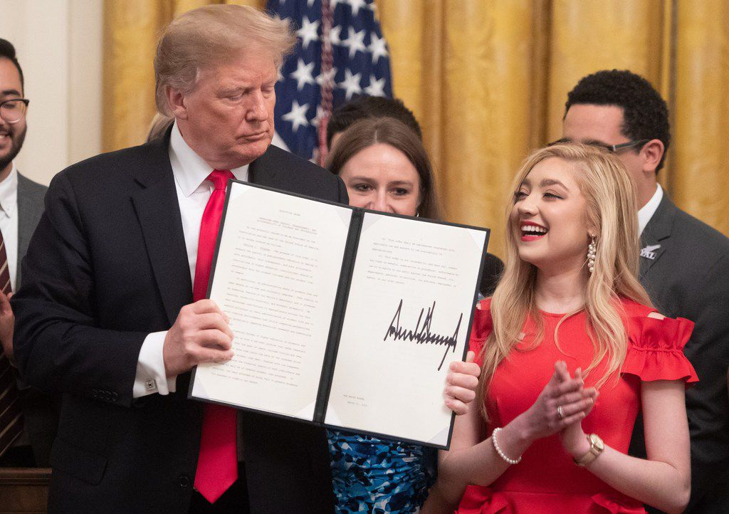 US President Donald J. Trump, alongside Justine Murray, a student at Syracuse University, after signing an executive order to protect free speech on college campuses during a ceremony in the East Room of the White House in Washington, DC, March 21, 2019. Two Texas senators were also in attendance at the signing ceremony, which occurred one day after the chamber passed a bill to prohibit public universities from rejecting controversial speakers.