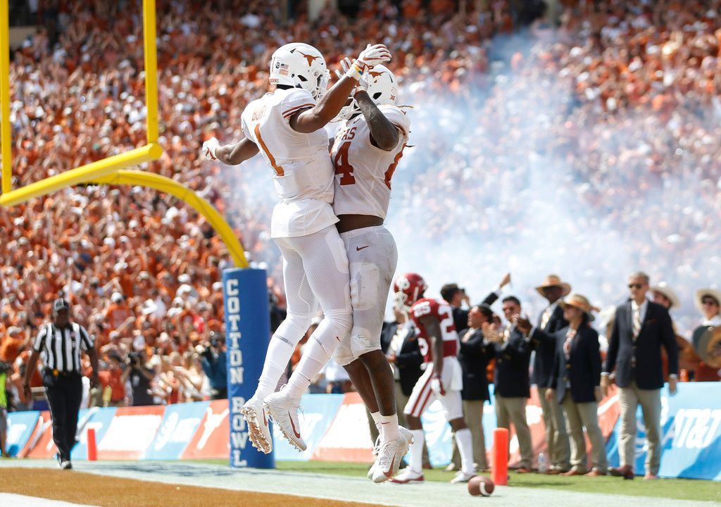 Texas Longhorns wide receiver Lil'Jordan Humphrey (84) celebrates with teammate Texas Longhorns wide receiver John Burt (1) after scoring a touchdown during the second half of play at the Cotton Bowl in Dallas on Saturday, October 6, 2018. Texas Longhorns defeated Oklahoma Sooners 48-45. (Vernon Bryant/The Dallas Morning News)