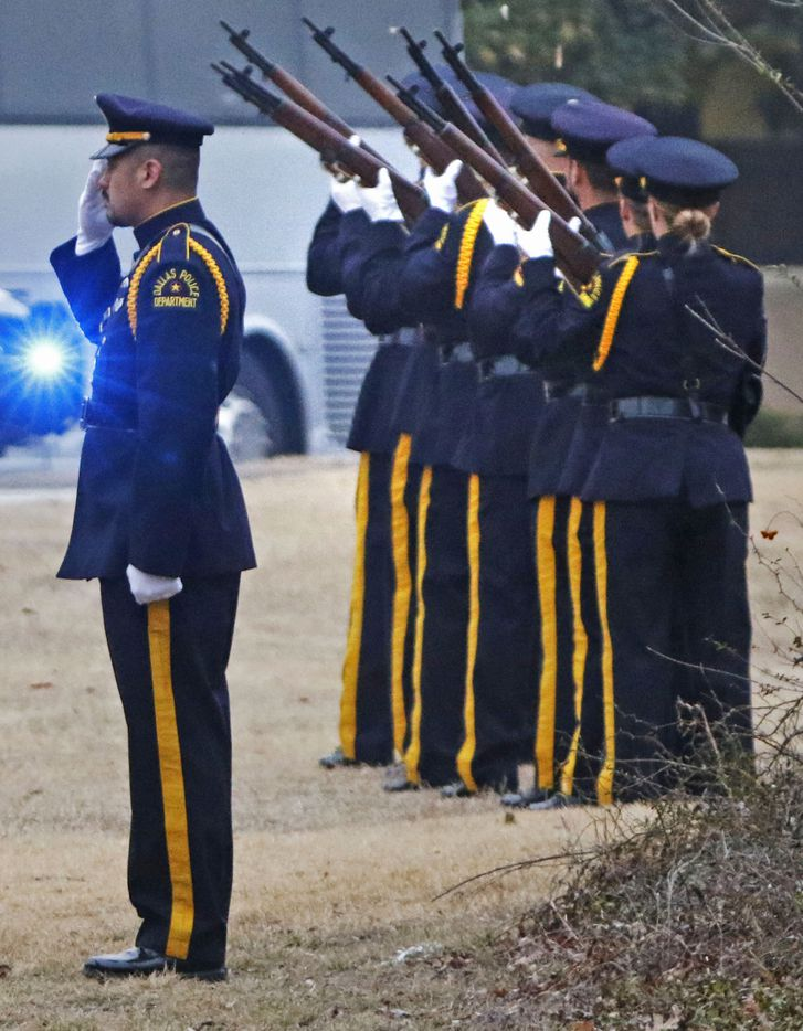Dallas police officers fire a 21-gun salute for Richardson police officer David Sherrard outside of Watermark Community Church in Dallas, Texas, Tuesday, February 13, 2018.