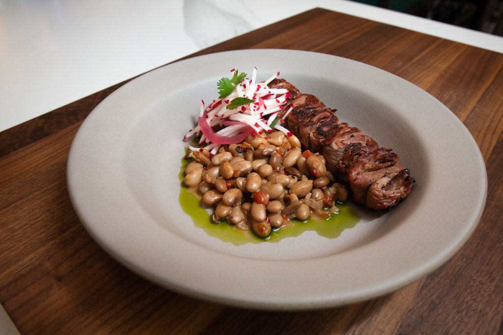 The skewered 2S Ranch grass-fed sirloin is brushed with fermented honey and served with borracho beans, radish and mint.