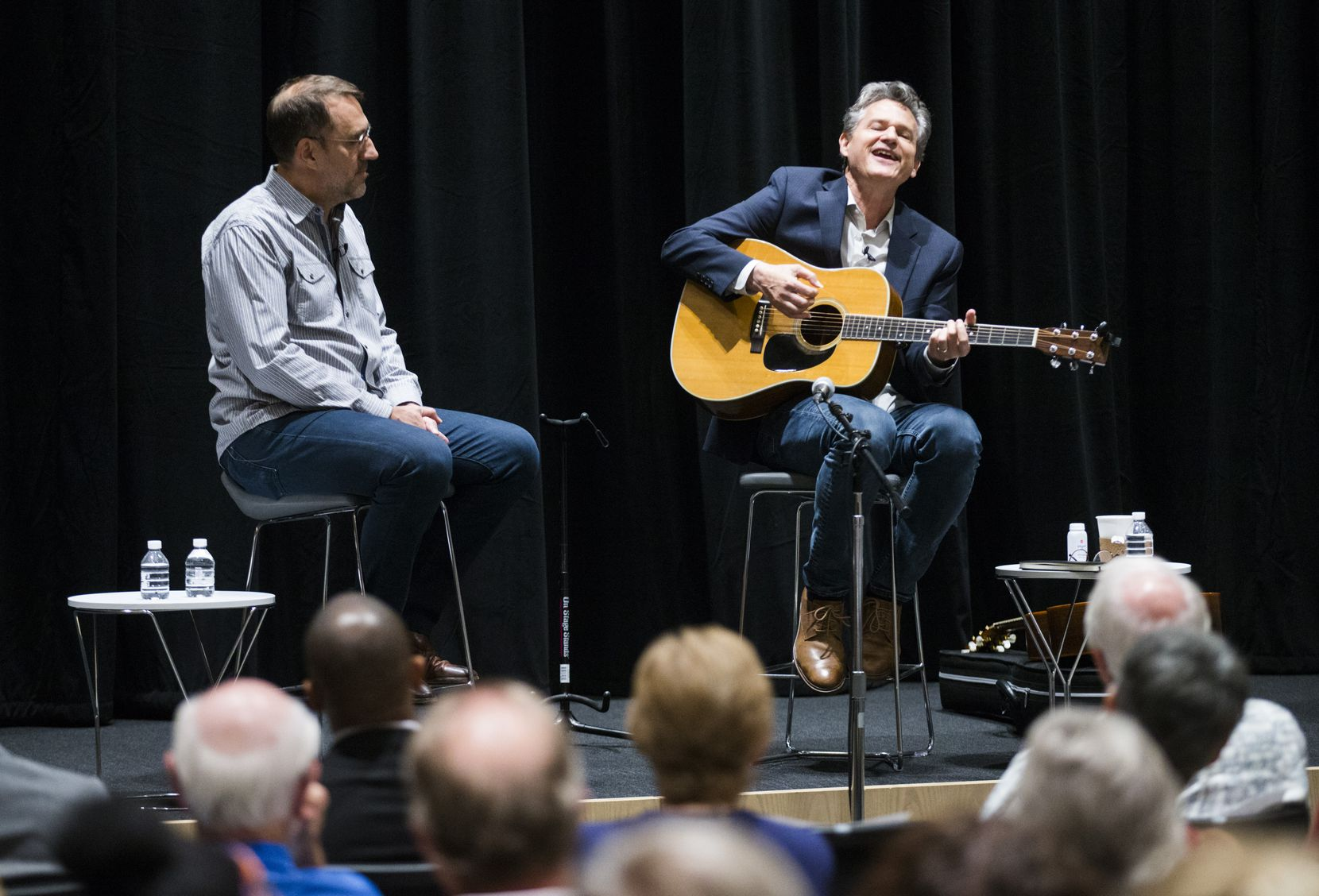 Billy Crockett, right, singer, songwriter and creative director of Blue Rock Studio in the Texas Hill Country, and Mike Wilson, left, editor of 'The Dallas Morning News,' participate in a 'Duets' subscriber event on October 1, 2019 at 'The Dallas Morning News'