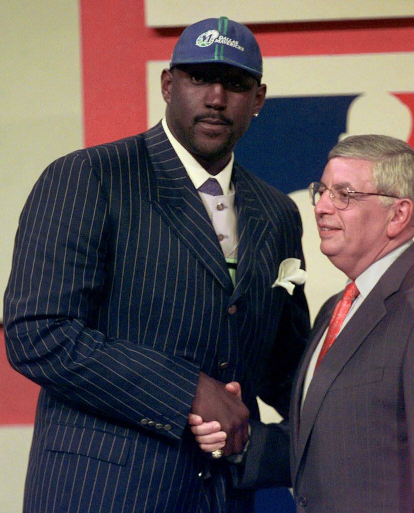 Robert Traylor shakes hands with NBA commisioner David Stern after being selected as the first round pick for the Dallas Mavericks in the 1998 NBA Draft at General Motors Place in Vancouver, British Columbia, Wednesday, June 24, 1998. Traylor, who played for Michigan, was selected as the sixth overall pick.