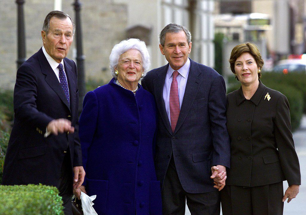 In this file photo taken on Jan. 26, 2002, President George W. Bush, his wife Laura, parents George H.W. Bush and former first lady Barbara Bush leave St. John's Episcopal Church after Sunday morning services across from the White House in Washington, D.C.