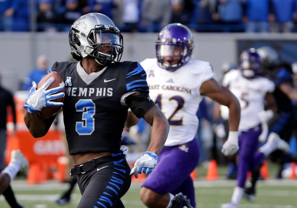 FILE - In this Nov. 25, 2017 file photo, Memphis wide receiver Anthony Miller (3) heads for a touchdown against East Carolina in the first half of a game in Memphis, Tenn. (AP Photo/Mark Humphrey, File)