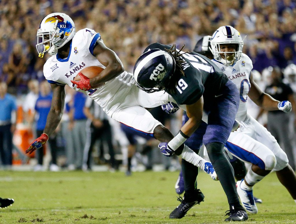 FILE - TCU Horned Frogs linebacker Montrel Wilson (19) tackles Kansas Jayhawks wide receiver Steven Sims Jr. (11) during the second quarter at Amon G. Carter Stadium in Fort Worth, Texas, Saturday, October 21, 2017. (Tom Fox/The Dallas Morning News)