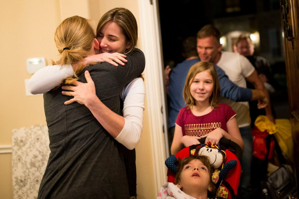 Penny Howard (left) greeted Katiele Fischer and the rest of the Fischer family as the Fischers arrived from Brazil at the Howard home in The Colony on Thursday. (Ting Shen/Staff Photographer)