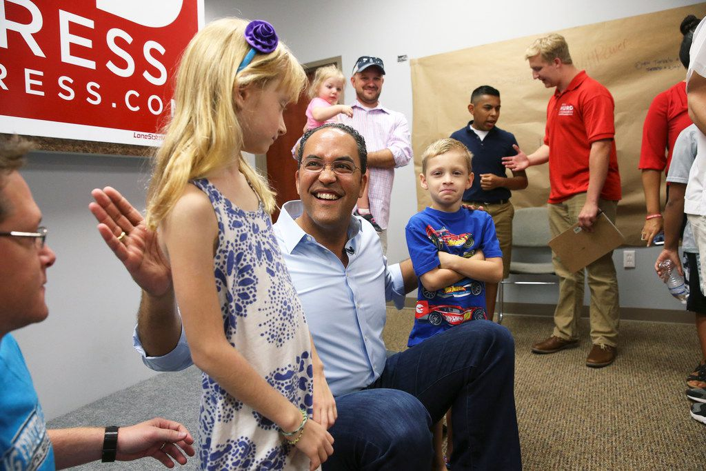 U.S. Congressman Will Hurd jokes with siblings Kyler and Bracken Purpura after he greets supporters at his northside headquarters on August 4, 2018.