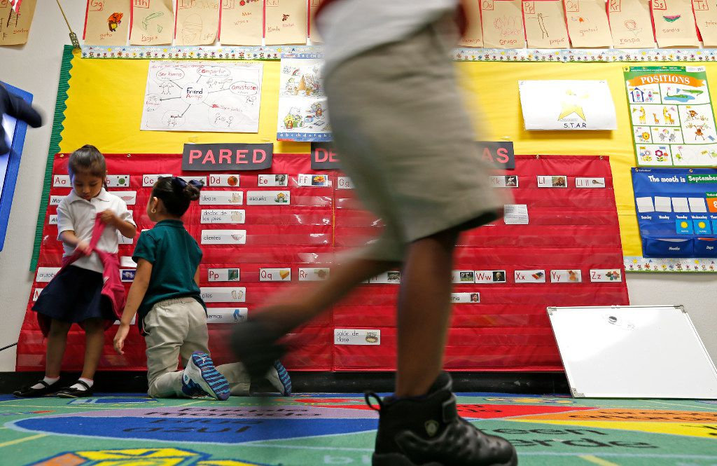 Alma Casiano (left) and Valeria Taboada play in a Pre-K classroom at N.W. Harllee Early Childhood Center in Dallas, Friday, Sept. 9, 2016. The business community is interested in early childhood education. (Jae S. Lee/The Dallas Morning News)
