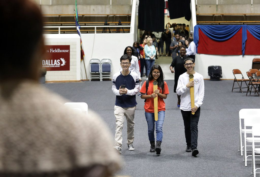 Co-valedictorians, 17-year-old Tri Truong, left, and 17-year-old Fatima Roque, center, rehearse their Townview School of Health Professions graduation entrance at the Alfred J. Loos Sports Complex in Addison, TX, on May 30, 2019. They are joined by Sorrells Education and Human Services Magnet valedictorian, 17-year-old Eddy Pineda, right, (Jason Janik/Special Contributor)